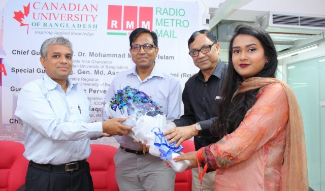Emamul Haque, Executive Director RMM received a bouquet of flowers from Professor Dr. Mohammad Mahfuzul Islam, Vice Chancellor of Canadian University of Bangladesh (CUB). RMM in partnership with CUB organized a free education workshop in Dhaka on 30 July 2018.